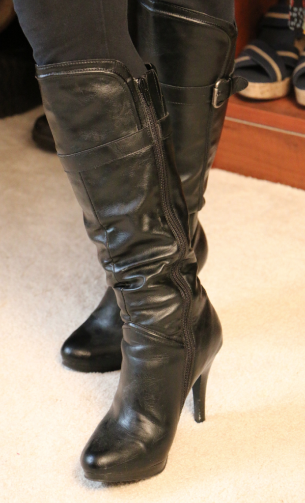 black leather high heeled zip up boots