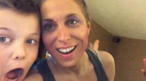 boy doing mom's makeup