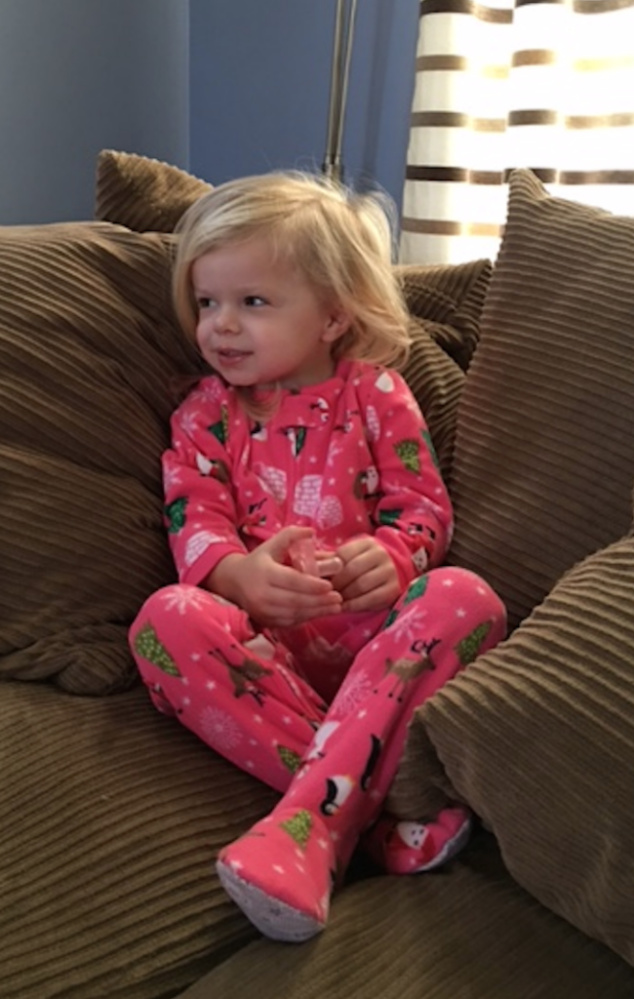 little girl in carters christmas pajamas