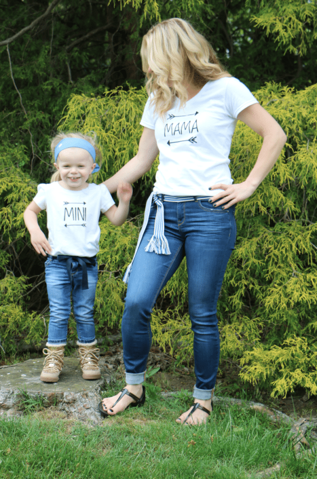 mom and girl wearing mommy and me matching tshirts