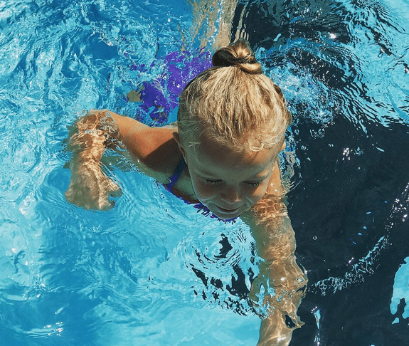 A still from the cutest video ever - my daughter learning to swim!