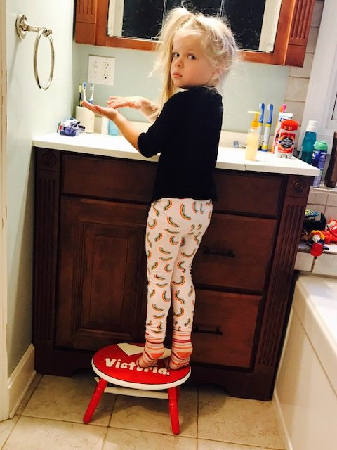 She looks so grown up stepping up to the sink on her own.