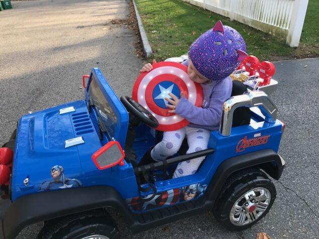 She loves the removable Captain America shield that came with her Dynacraft Avengers 4x4.