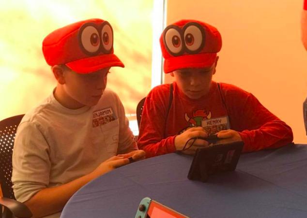 The boys even got fun hats at Nintendo Headquarters.
